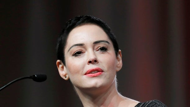 "FILE- In this Oct. 27, 2017, file photo, actress Rose McGowan speaks at the inaugural Women's Convention in Detroit. McGowan spoke to TV critics Tuesday about her upcoming documentary series ""Citizen Rose"" and what she called her global struggle against sexual assault and economic injustice. She has been privately taping her life for several years, joining with Bunim-Murrary Productions to create the documentary series. (AP Photo/Paul Sancya, File)"