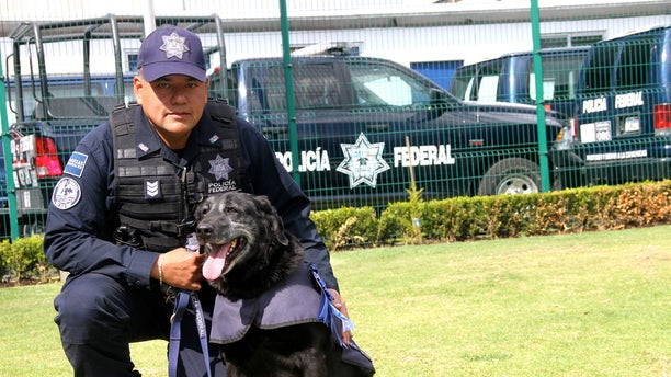 Deputy Officer Jorge Luis López and Rosty.