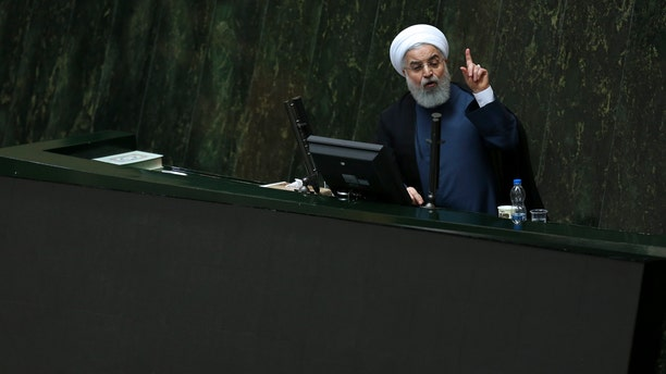 Iranian President Hassan Rouhani speaks in a session of the parliament while answering questions of lawmakers, in Tehran, Iran, Tuesday, Aug. 28, 2018.