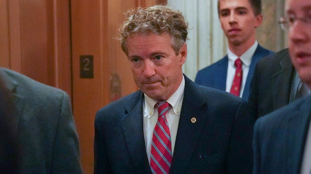 Sen. Rand Paul, R-Ky., arrives on Capitol Hill in Washington, Monday, Nov. 13, 2017. Paul entered the chamber, hands by his sides, to cast a vote.