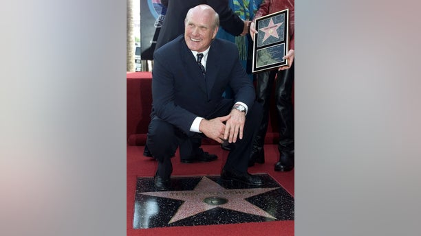 Former Pittsburgh Steelers quarterback and Emmy award winning television football commentator Terry Bradshaw poses with his newly unveiled star on the Hollywood Walk of Fame. He was named the Super Bowl MVP in 1979 and 1980.