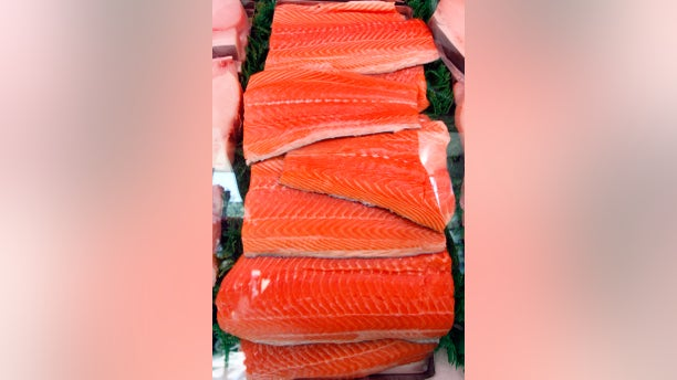 Slabs of Salmon are displayed at a market in Santa Monica, California October 3, 2007. REUTERS/Lucy Nicholson