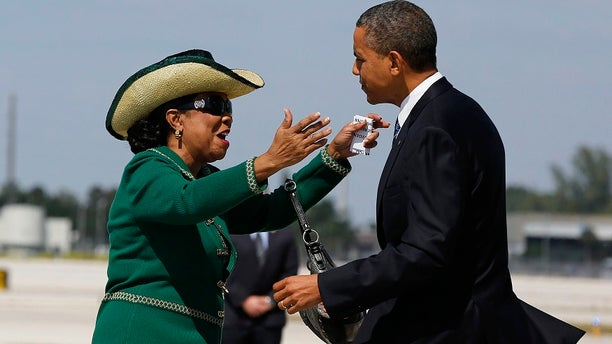 Rep. Frederica Wilson, D-Fla., greets then-President Barack Obama after he arrived in Miami in 2012.