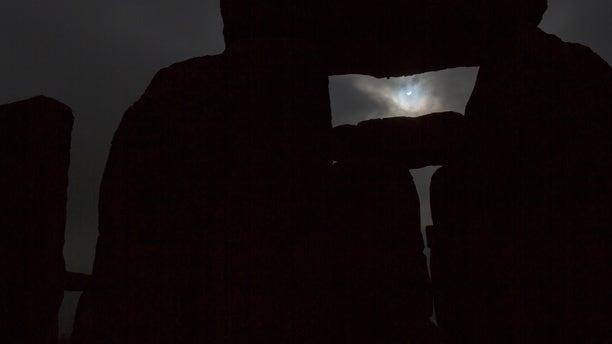 File photo: The solar eclipse is seen over Stonehenge on Salisbury Plain, Salisbury, southern England March 20, 2015. (REUTERS/Kieran Doherty)