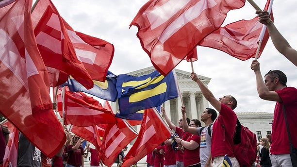 Supporters of gay marriage rally in front of the Supreme Court ahead of its landmark decision to legalize it nationwide.
