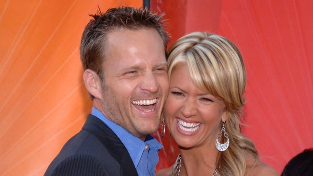 Actress Nancy O'Dell (R) and husband Keith Zubchevich arrive at the NBC Allstar Party held at the Century Club in Los Angeles July 25, 2005.