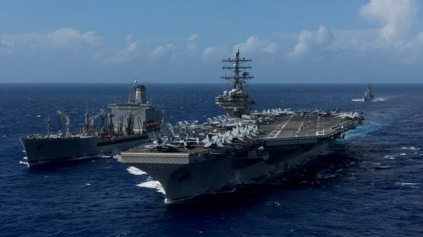 FILE -- U.S. Navy's forward-deployed aircraft carrier USS Ronald Reagan is seen during a replenishment-at-sea with the Military Sealift Command's fleet replenishment oiler USNS John Ericsson in waters around Okinawa southwest of the Korean peninsula, October 9, 2017.