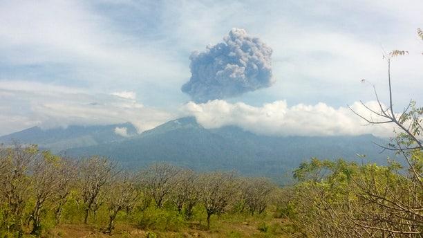 Mount Barujari, located inside Mount Rinjani volcano, is seen erupting from Bayan district, North Lombok, Indonesia.
