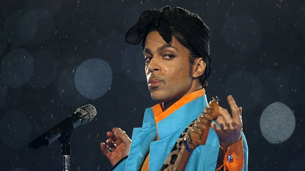 Prince performs at the Super Bowl halftime show in 2007
