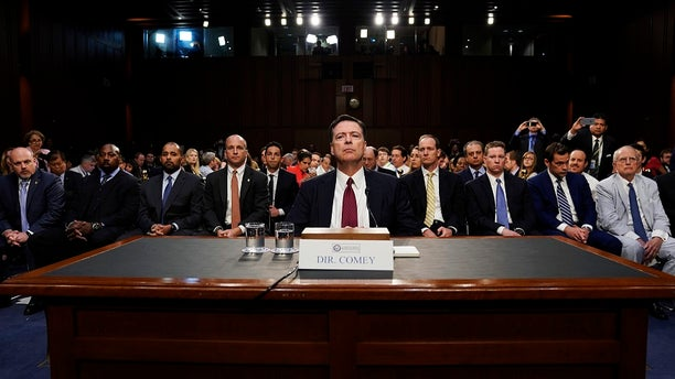 Former F.B.I. Director James Comey testifies before a Senate Intelligence Committee hearing on Russia's alleged interference in the 2016 presidential election.