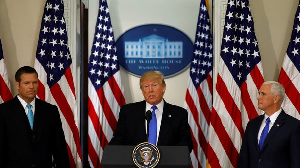 President Donald Trump speaks at the first meeting of the Presidential Advisory Commission on Election Integrity co-chaired by Kansas Secretary of State Kris Kobach (L) and Vice President Mike Pence (R).