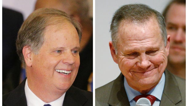 A combination photo shows Democratic Alabama U.S. Senate candidate Doug Jones (L) and Republican U.S. Senate candidate Roy Moore (R) at their respective election night parties in Birmingham and Montgomery, Alabama.