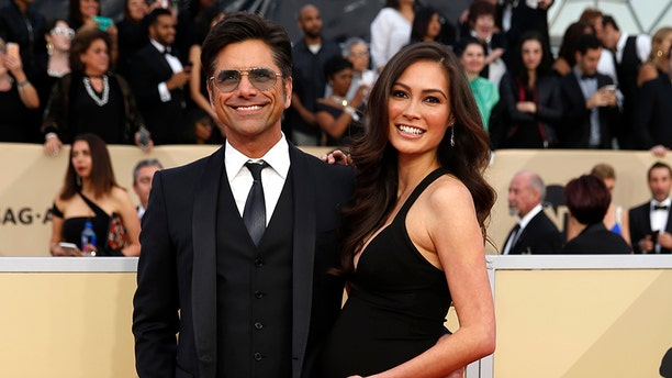 John Stamos and Caitlin McHugh announced in December that they were expecting a baby.