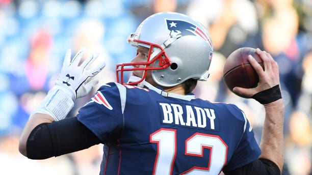 New England Patriots quarterback Tom Brady warms up before the AFC Championship Game against the Jacksonville Jaguars at Gillette Stadium