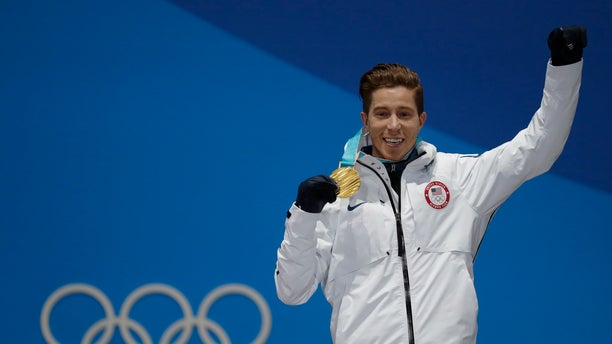 Gold medallst Shaun White of the U.S. on the podium.