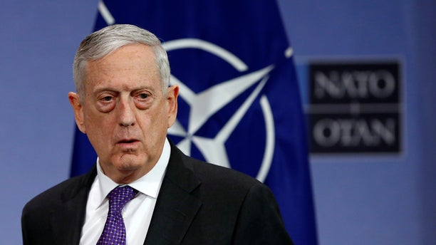 New allegations stem from a decision by Defense Secretary Jim Mattis, pictured, to fire the overseer of military commissions, Harvey Rishikof, which coincided with Rishikof's secret exploration of the possibility of guilty pleas to resolve the trial of alleged 9/11 plot mastermind Khalid Sheik Mohammed and four alleged accomplices.