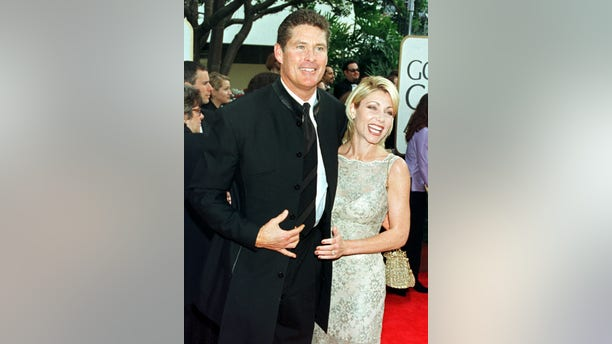 """Baywatch"" star David Hasselhoff and his wife Pamela Bach arrive at the 55th annual Golden Globe Awards in Beverly Hills, January 18. The Golden Globe Awards, sponsored by the Hollywood Foreign Press Association, honors excellence in film and television. - RTXIM7B"