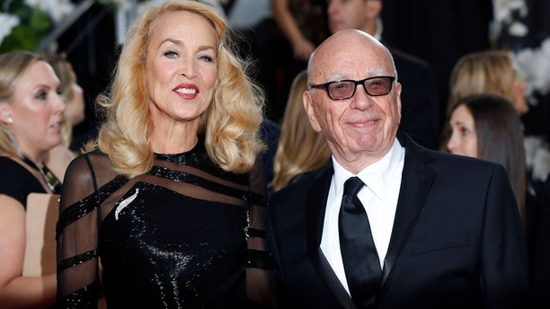 Model Jerry Hall and Rupert Murdoch arrive at the 73rd Golden Globe Awards in Beverly Hills, California January 10, 2016.  REUTERS