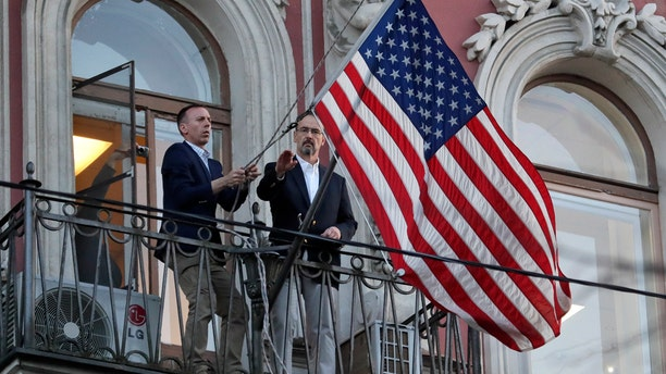Consulate employees remove the U.S flag at the U.S. consulate in St.Petersburg, Russia, March 31, 2018.