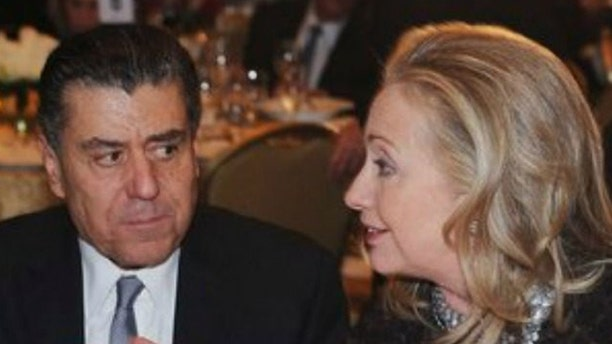 Haim Saban, (l.), has given $3.5 million to the presidential campaign of Hillary Clinton, (r.). (Reuters)