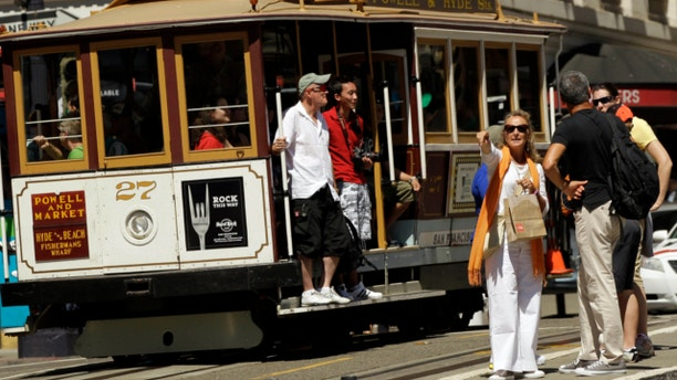 Sept. 1, 2010: Visitors wait to board a cable car in San Francisco's Union Square.