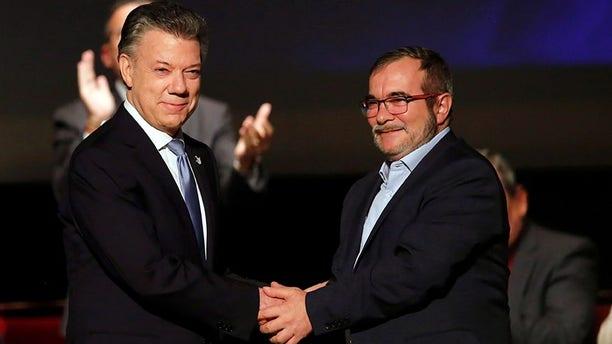 Colombia's President Juan Manuel Santos and Marxist FARC rebel leader Rodrigo Londonoin Bogota, Colombia November 24, 2016.