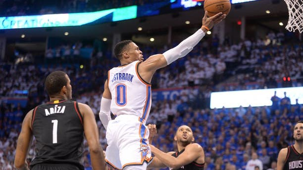 Apr 21, 2017; Oklahoma City, OK, USA; Oklahoma City Thunder guard Russell Westbrook (0) drives to the basket between Houston Rockets forward Trevor Ariza (1) and Houston Rockets guard Eric Gordon (10) during the fourth quarter in game three of the first round of the 2017 NBA Playoffs at Chesapeake Energy Arena. Mandatory Credit: Mark D. Smith-USA TODAY Sports