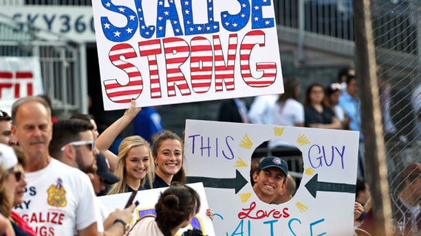 Supporters of House Majority Whip Steve Scalise, R-La., hold signs before the Congressional baseball game, Thursday, June 15, 2017, in Washington. The annual GOP-Democrats baseball game raises money for charity. (AP Photo/Alex Brandon)