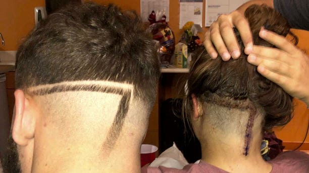 Ethan McMullan, a college freshman from Decatur, Miss., brought a picture of his sister's scar to his local barber and asked him to replicate the markings in his hair.