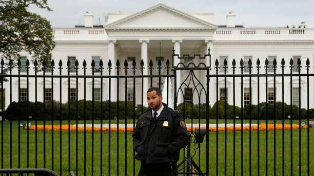 Oct. 23, 2014: A member of the U.S. Secret Service stands guard in front of the North Lawn of the White House in Washington