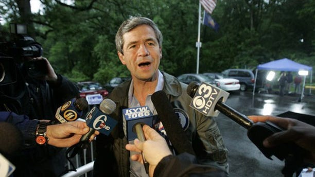 Rep. Joe Sestak talks to reporters as he enters the polling place to vote in the Democratic primary in Gradyville, Pa., May 18. (Reuters Photo)