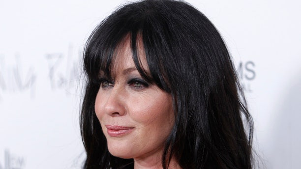 "Cast member Shannen Doherty poses at the premiere of the film ""Burning Palms"" at the Arclight theatre in Hollywood, California, January 12, 2011. REUTERS/Danny Moloshok (UNITED STATES - Tags: ENTERTAINMENT HEADSHOT) - RTXWI4Q"
