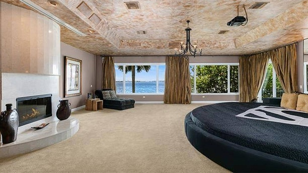 The master bedroom features a round bed frame measuring 15 feet across.