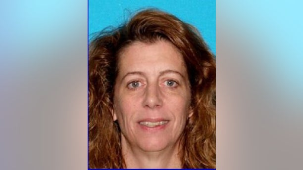 Authorities in Maine say Carol Sharrow, 51, drove onto a baseball diamond Friday night, killing a man.