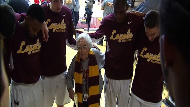 Sister Jean prays with the team before every game.
