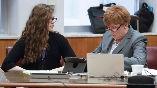 Anissa Weier, left, talks to her attorney Maura McMahon during jury selection.