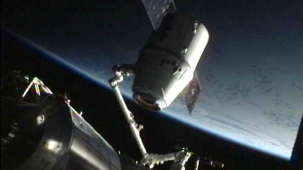 SpaceX's Dragon space capsule is detached from its docking port on the International Space Station on May 31, 2012 ahead of the spacecraft's return to Earth to end its first voyage to the orbiting lab.