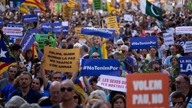 People participate in a demonstration condemning last week's attacks that killed 15 people in Spain.