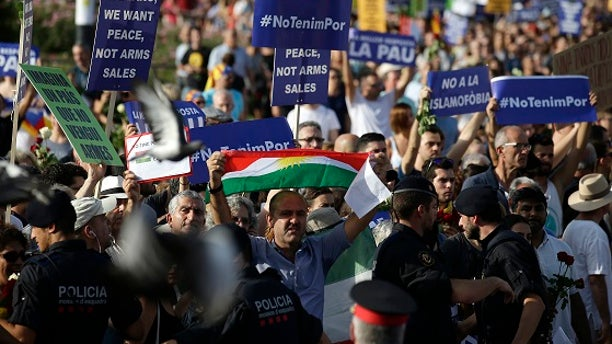 Barcelona police said some 500,000 people showed up to the march Saturday, Aug. 26, 2017.