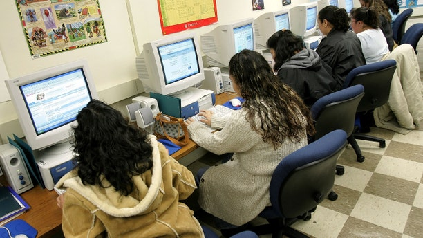 CHICAGO - MAY 02: Students work on computers at the Community Learning Resource Center May 2, 2005 at Perez Elementary School in the largely Hispanic Pilsen neighborhood in Chicago, Illinois. Spanish-speaking residents in the Chicago Public School (CPS) district will have the opportunity to learn basic computer skills at no cost through a partnership between the CPS Office of Language and Cultural Education and the Mexican university Tecnologico de Monterrey, in Monterrey, Mexico. Upon completion of the 16-week program, parents will receive a diploma from the Tecnologico de Monterrey. (Photo by Tim Boyle/Getty Images)