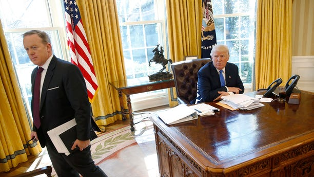 White House Communications Director and spokesman Sean Spicer (L) stands with U.S. President Donald Trump at the conclusion of an interview with Reuters in the Oval Office at the White House in Washington, U.S. February 23, 2017. REUTERS/Jonathan Ernst - RTS101X8
