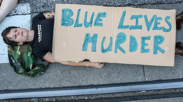 """A protester participates in a """"Die-In"""" during a second day of demonstrations after a not guilty verdict in the murder trial of former St. Louis police officer Jason Stockley."""