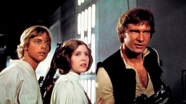 """This photo provided by Twentieth Century Fox Home Entertainment shows, Mark Hamill, from left, as Luke Skywalker, Carrie Fisher as Princess Leia Organa, and Harrison Ford as Hans Solo in the original 1977 """"Star Wars: Episode IV - A New Hope."""" The  four-day Star Wars Celebration kicked off Thursday, April 13, 2017 in Orlando, Fla., marking the 40-year anniversary of Lucas' space saga. (Twentieth Century Fox Home Entertainment via AP)"""