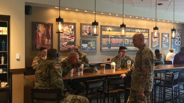 """April 24, 2017: Active military personnel from Fort Campbell gather at one of Starbucks' new """"Military Family Stores"""" in Clarksville, Tenn."""