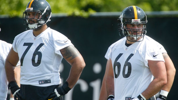 Pittsburgh Steelers offensive tackle Mike Adams (76) and guard David DeCastro (66) wait for the next drill during NFL football practice on Thursday, May 30, 2013 in Pittsburgh.