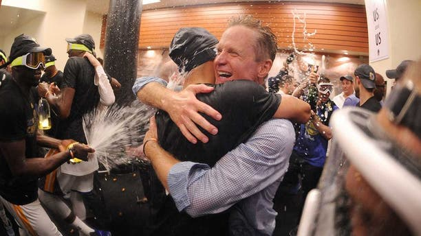 OAKLAND, CA - JUNE 12: Head Coach Steve Kerr of the Golden State Warriors celebrates in the locker room after defeating the Cleveland Cavaliers in Game Five of the 2017 NBA Finals on June 12, 2017 at Oracle Arena in Oakland, California. NOTE TO USER: User expressly acknowledges and agrees that, by downloading and or using this photograph, user is consenting to the terms and conditions of Getty Images License Agreement. Mandatory Copyright Notice: Copyright 2017 NBAE (Photo by: Noah Graham/NBAE via Getty Images)