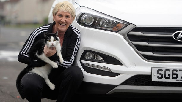 A relieved Sharon Stirling and her cat Jacob.