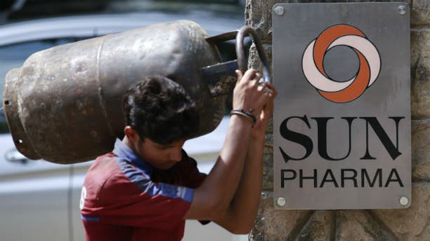 A man carrying a gas cylinder walks out of the research and development centre of Sun Pharmaceutical Industries Ltd in Mumbai May 29, 2014. (REUTERS/Danish Siddiqui)