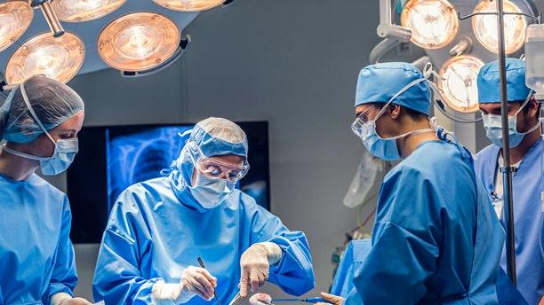 Surgeon team operating.