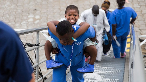 In September, nurses carried 11-year-old Justine up the gangway of Mercy Ships, a charity-run hospital ship that delivers free health care to less developed parts of the world.